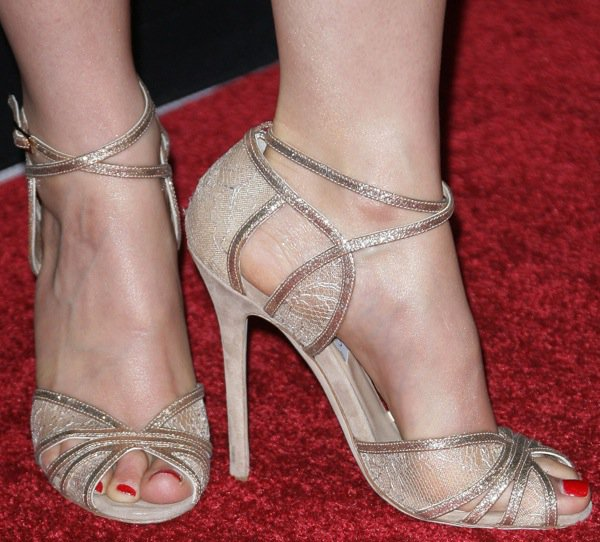 Ashley Judd shows off her size 8 (US) feet in gold Jimmy Choo heels