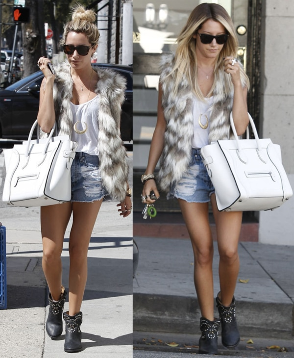 "Ashley Tisdale in a pair of Isabel Marant ""Caleen"" boots, cutoff jean shorts, a white tank, and a fur vest"
