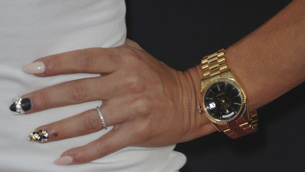 Cara Santana showing off her nails, watch, and rings