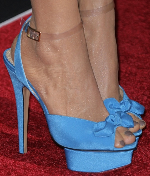 Charlotte Ross shows off her 7.5 (US) size feet in blue bow-embellished Charlotte Olympia platforms