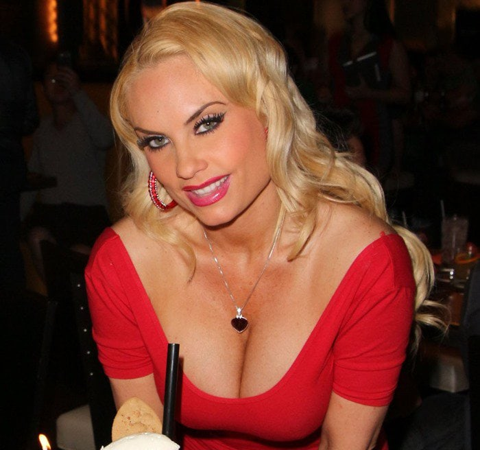 Coco Austin in a red short-sleeved skin-tight dress
