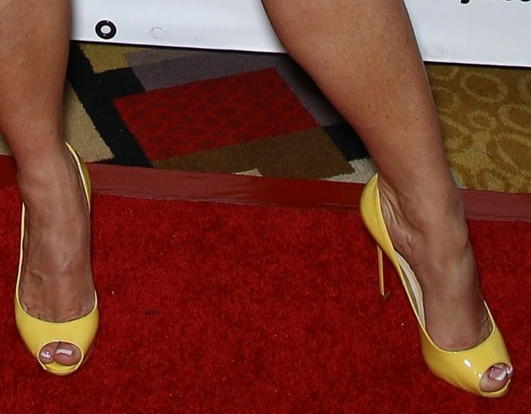 Coco Austin in bright yellow Christian Louboutin Flo peep-toe pumps