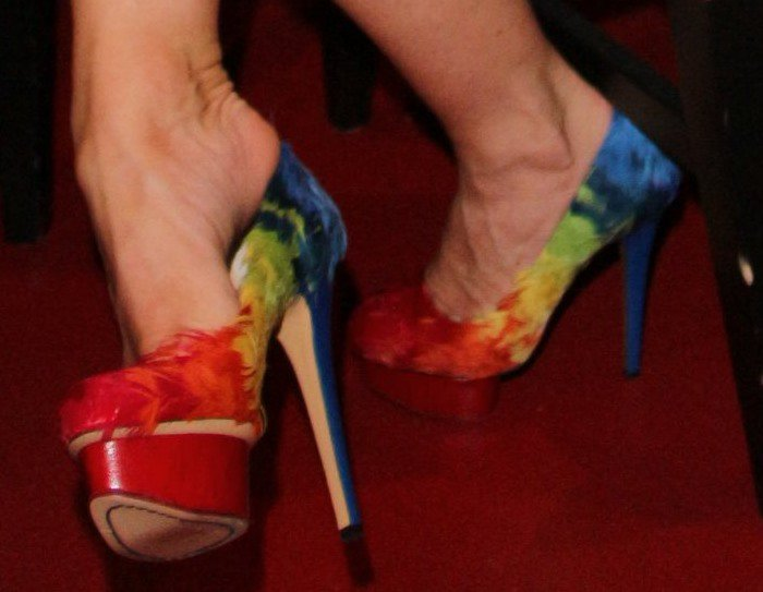 Coco Austin showing off her rainbow-feathered pumps