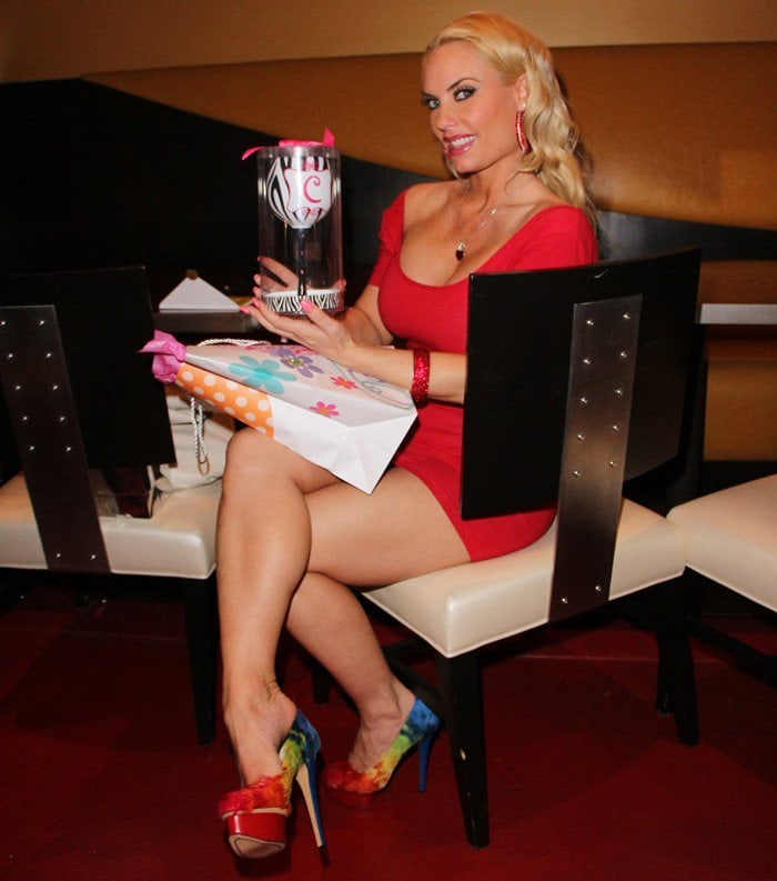 "Coco Austin rocking rainbow-feathered ""Dolly"" pumps from Charlotte Olympia"