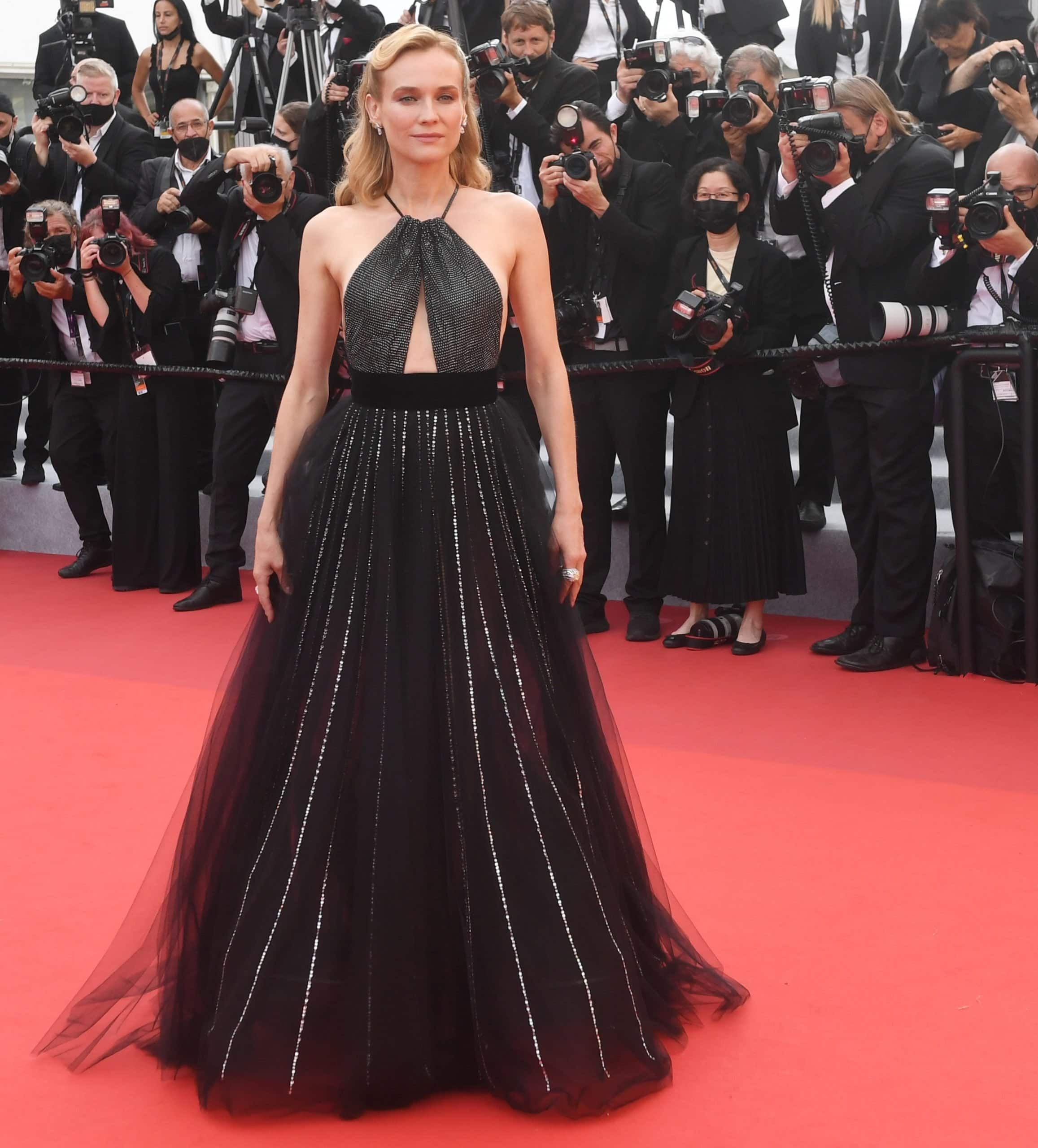 Diane Kruger in a bejeweled Armani Prive dress at the 2021 Cannes Film Festival for the premieres of Tout S'est Bien Passe and The Velvet Underground