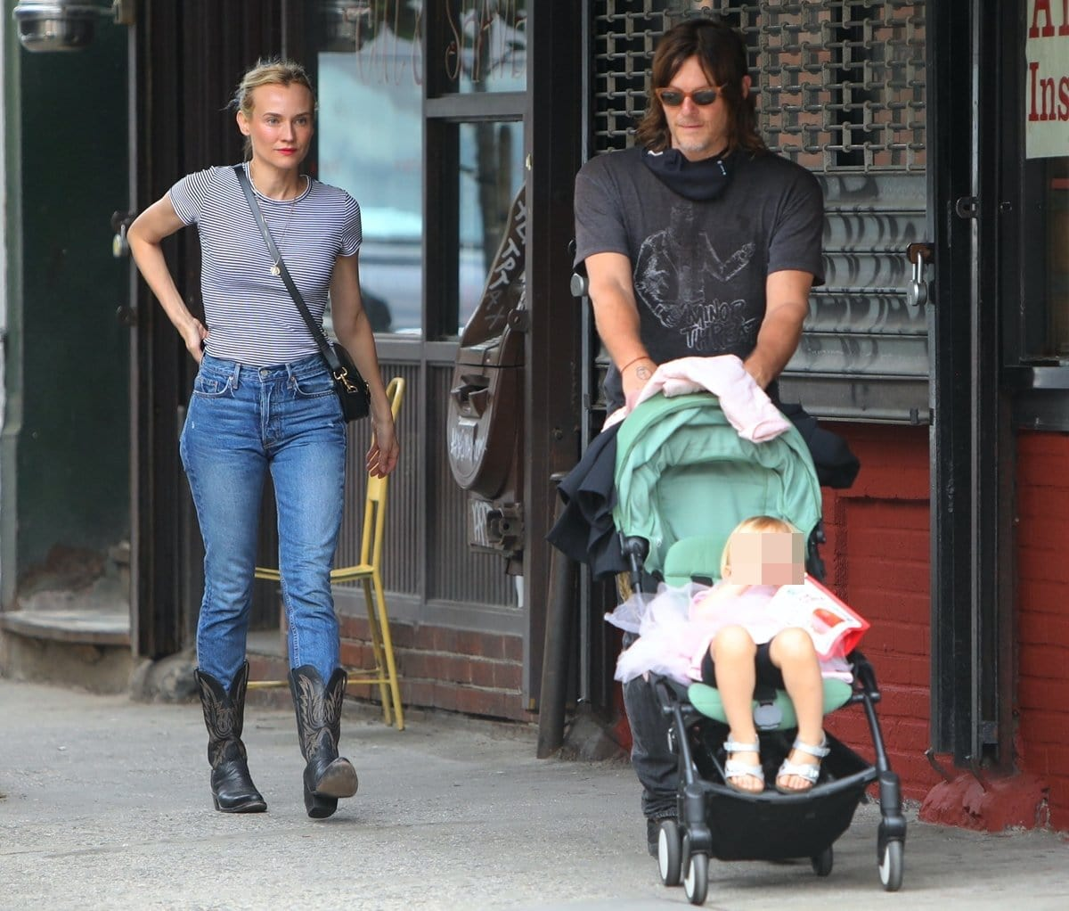 Diane Kruger and Norman Reedus are seen with their daughter