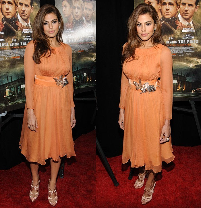 Eva Mendes wearing a Prada dress with strange floral butterfly accouterments