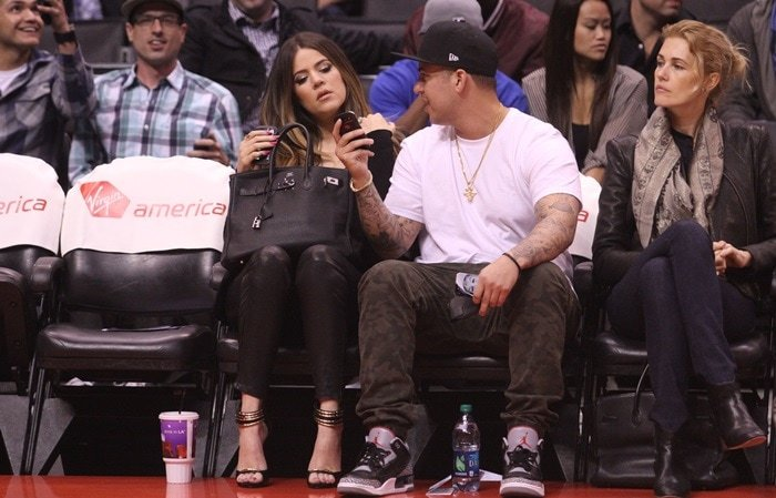 Khloe Kardashian and Rob Kardashian watching the LA Clippers vs. Milwaukee Bucks game at the Staples Center in Los Angeles on March 6, 2013