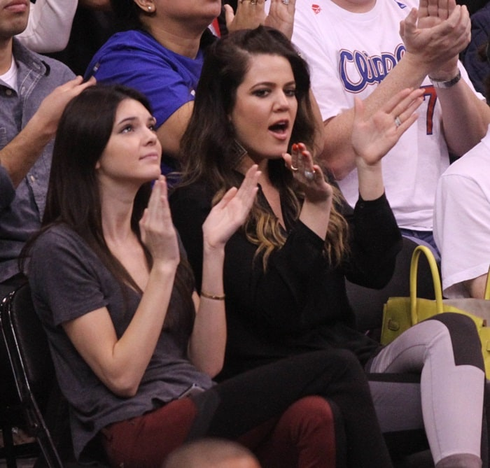 Khloe Kardashian and Kendall Jenner watching the LA Clippers vs. Milwaukee Bucks game at the Staples Center in Los Angeles on March 6, 2013