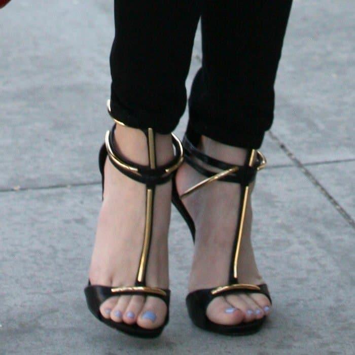 Khloe Kardashian's feet in strappy Giuseppe Zanotti sandals
