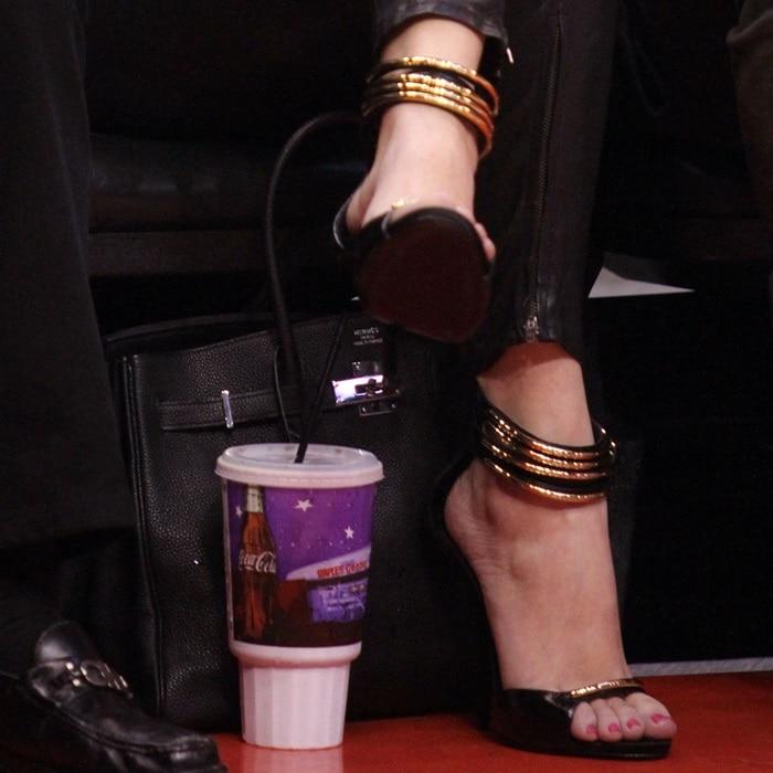 Khloe Kardashion in Giuseppe Zanotti embellished ankle-cuff gold tube sandals