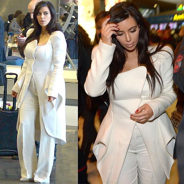 Kim Kardashian wears her hair down as she arrives at Charles de Gaulle Airport in Paris