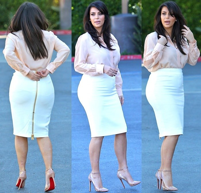 Kim Kardashian sported a white high-waist pencil skirt from Tom Ford with a gold zipper detail in the back paired with a light peachy-pink long-sleeve blouse from Chloé