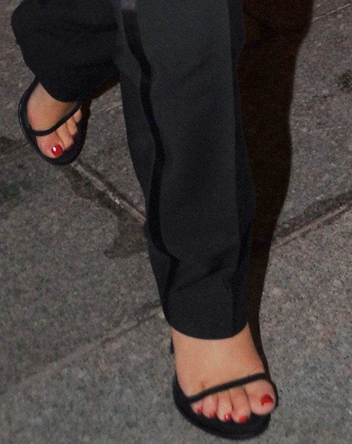 Kim Kardashian's feet in strappy black Saint Laurent sandals