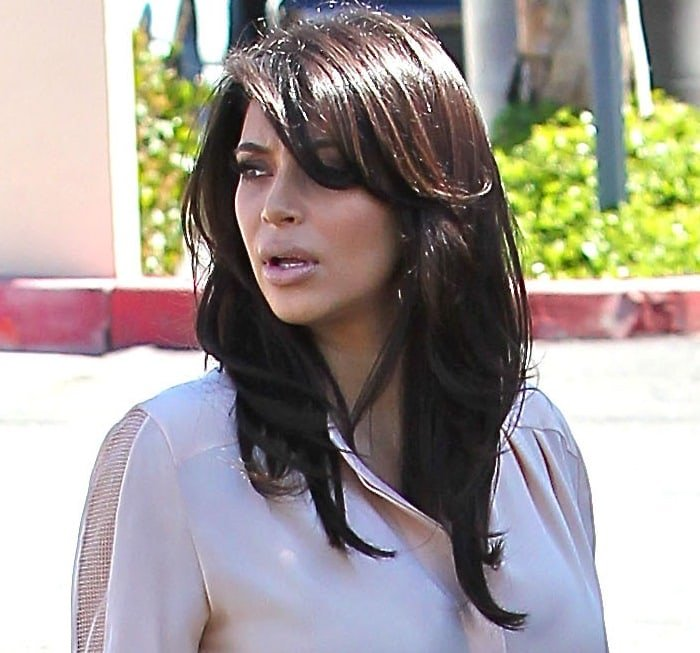 A pregnant Kim Kardashian is seen heading to an office while filming her reality series