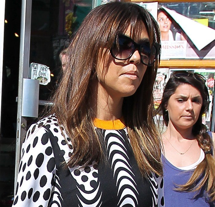 """Kourtney Kardashian wears her hair down as she shops at Wacko while filming scenes for the """"Keeping Up With the Kardashians"""" reality show"""