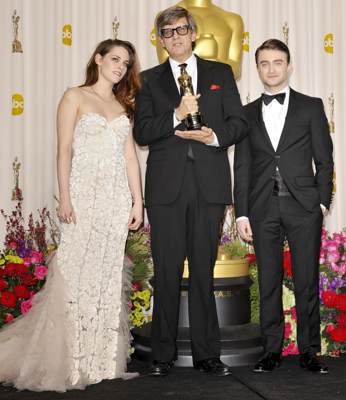 Actress Kristen Stewart, Rick Carter, and Daniel Radcliffe at the 85th Annual Academy Awards Press Room