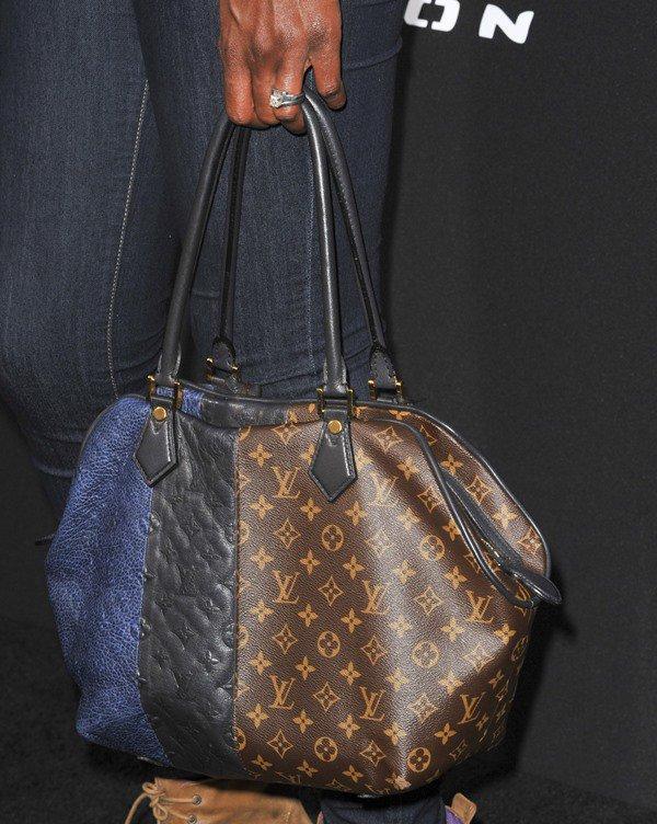 Lisa Leslie carried a Louis Vuitton bag
