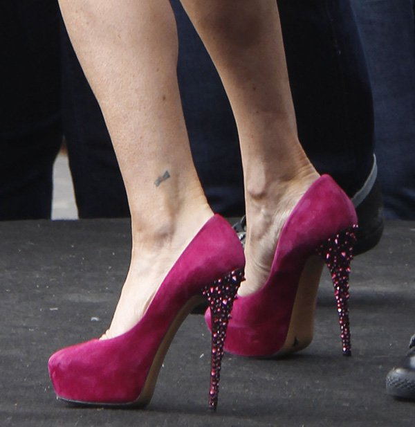 Lisa Vanderpump in berry colored suede and studded Casadei pumps