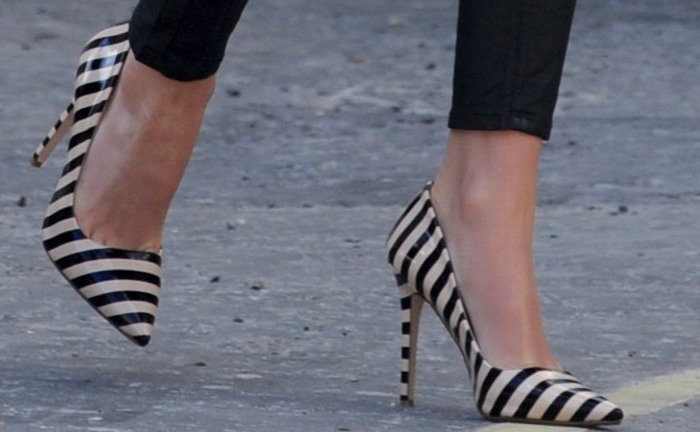 Lydia Bright's feet in striped Dune pumps