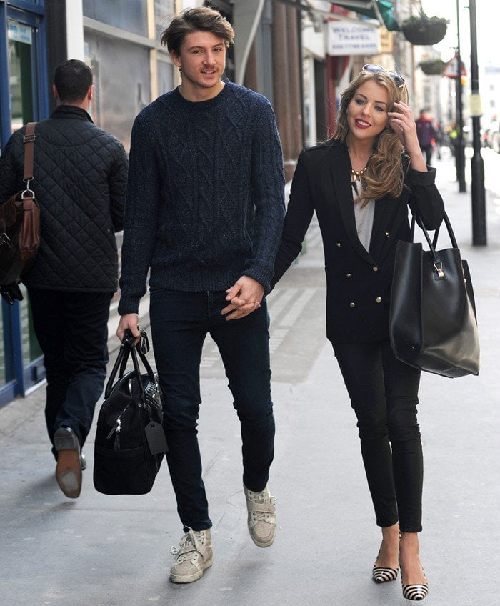 Lydia Bright shows off her new darker, longer hair while out and about in central London with boyfriend Tom Kilbey