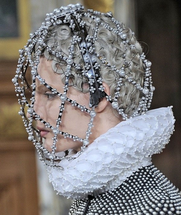 Model wearing a bejeweled headpiece from Alexander McQueen
