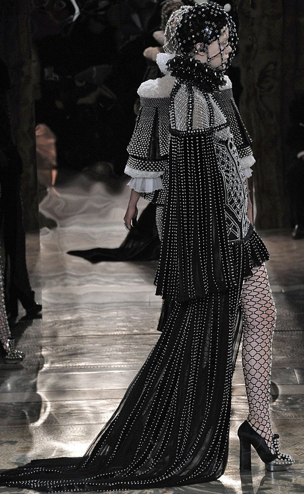 Model wearing a bejeweled headdress at the Alexander McQueen Autumn Winter 2013 fashion show