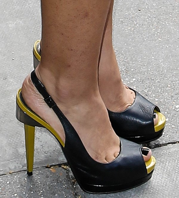 Nazaneen Ghaffar reveals toe cleavage in black slingbacks with contrast trimming and heels