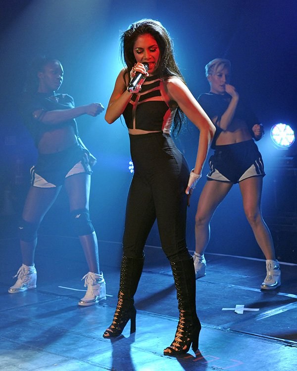 Nicole Scherzinger styled the dress with white fingerless gloves and black knee-high boots with cutout details