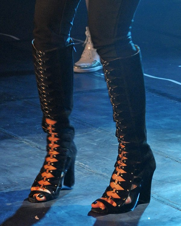 Nicole Scherzinger's boots featurecutouts and metal ring details down the front