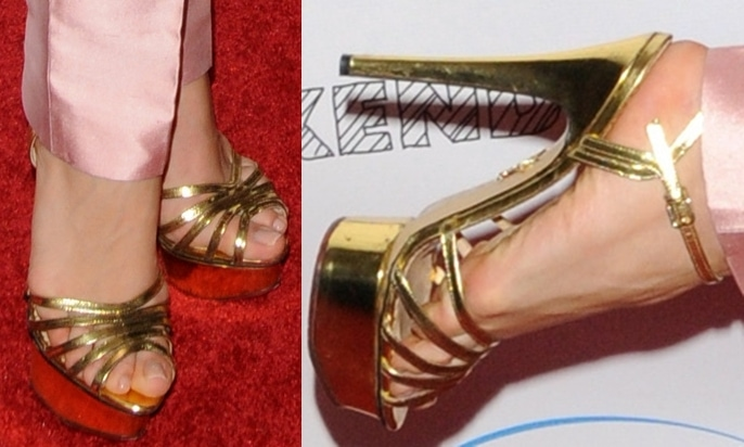 Olesya Rulin shows off her size 6 (US) feet in strappy gold platform sandals