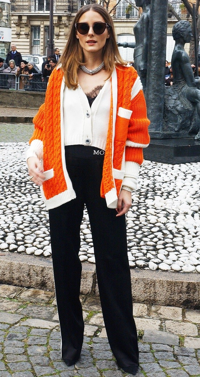 Olivia Palermo in a sporty-chic look attends the Miu Miu Fall 2019 show