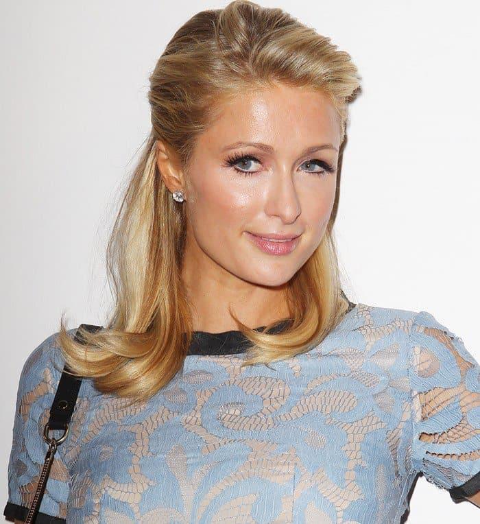 Paris Hilton ina ladylike two-tone lace dress