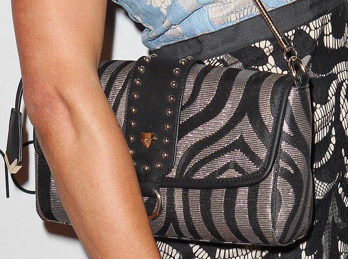 Paris Hilton toting one of her many designer handbags