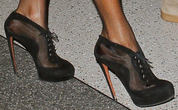Paris Hilton's feet in black booties