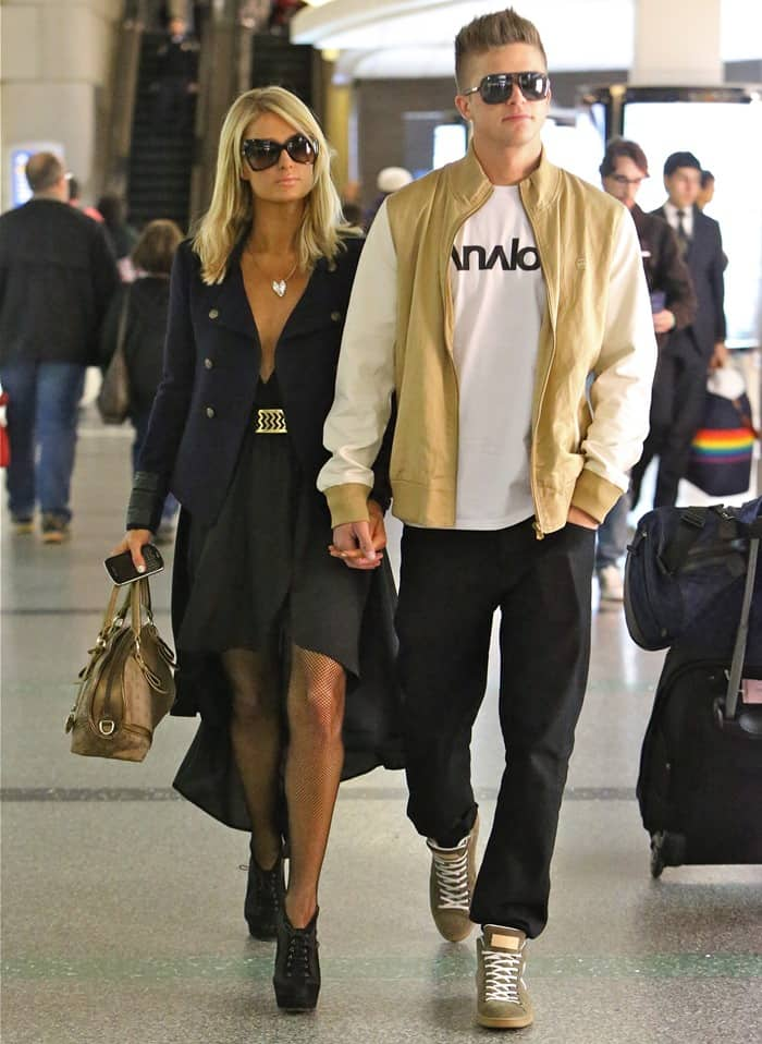 Paris Hilton on her way to catch a long-haul flight to Barcelona with her boyfriend