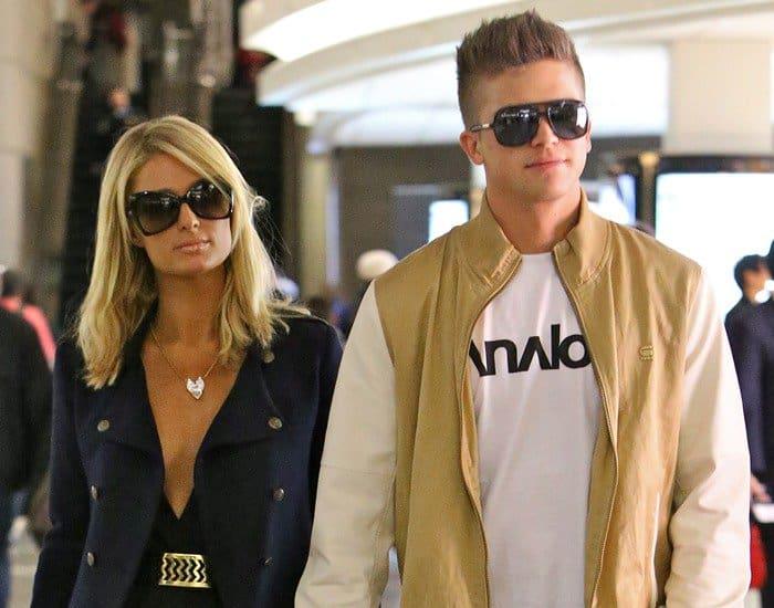 Paris Hilton and boyfriend River Viiperi seen arriving at LAX