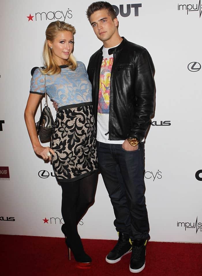 Paris Hilton posing with her boyfriend, River Viiperi, a Spanish-Finnish model