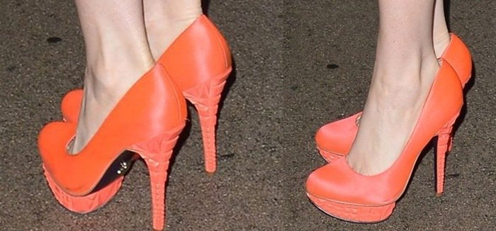 Phoebe Price shows off the orange detailing on her bright Rachel Roy pumps