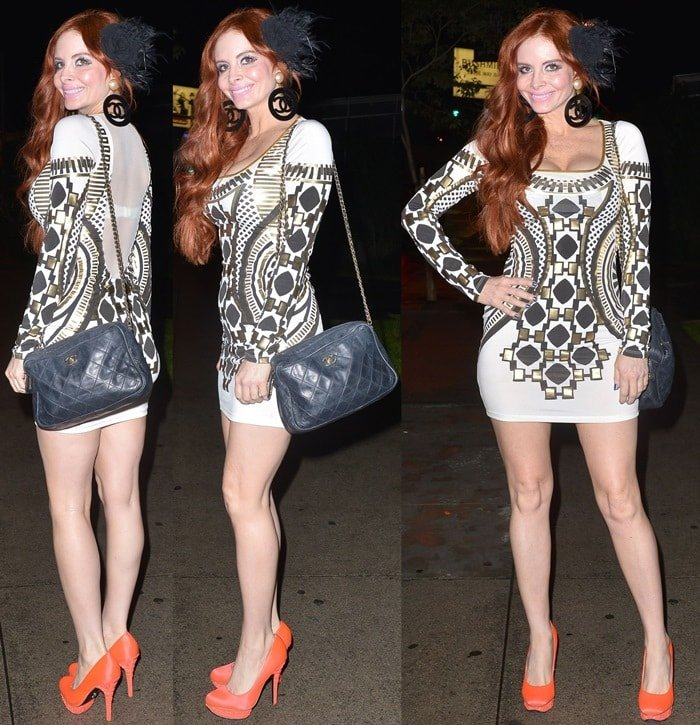 Phoebe Price shows off her white printed minidress and orange heels at a Los Angeles dinner