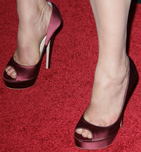 Radha Mitchell shows off her size 7 (US) feet in burgundy peep-toe platform pumps