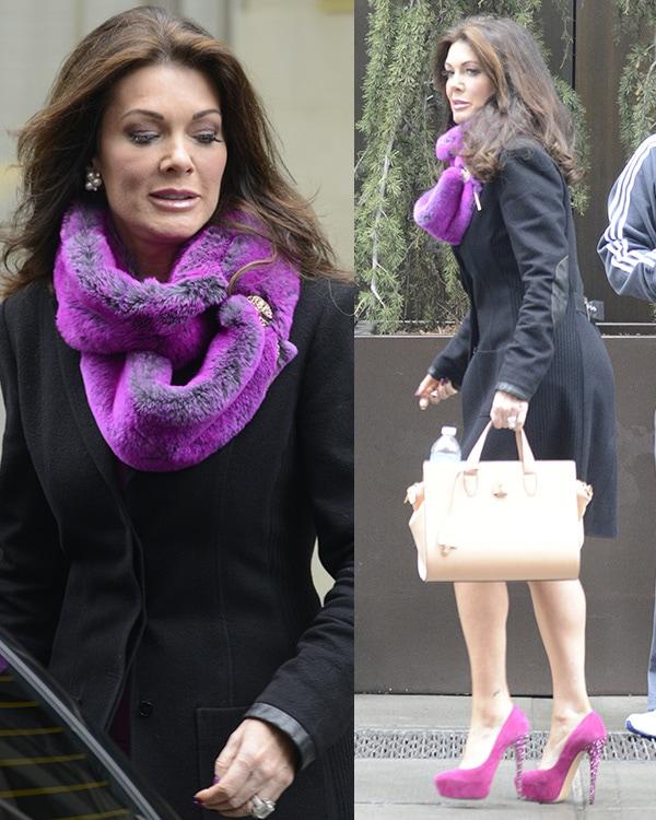 Reality star Lisa Vanderpump in a purple dress and a black coat