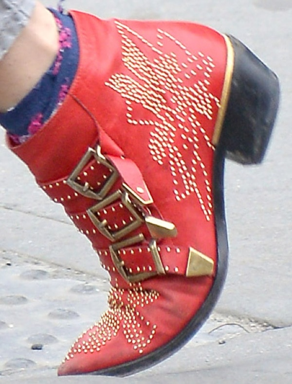 Sienna Miller wearing red Chloé 'Suzanne' stud buckle booties