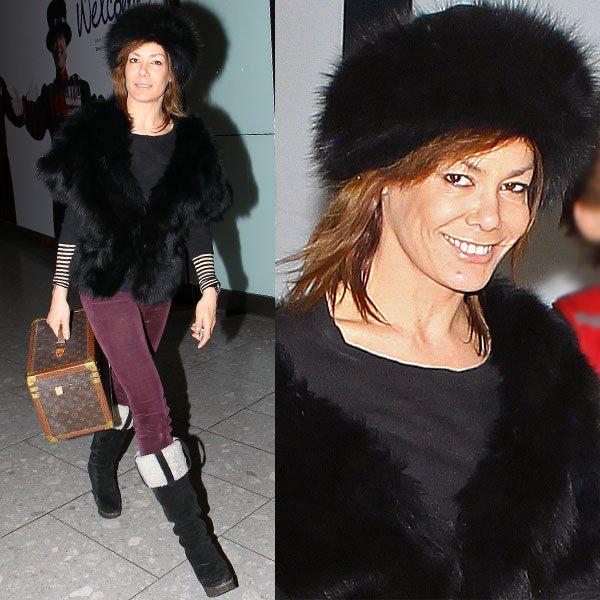 Tara Palmer-Tomkinson in a more sensible footwear at Heathrow Airport in London, England on December 11, 2012