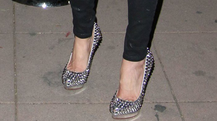 "Tara Reid's feet in silver spiked Christian Louboutin ""Alti"" pumps"