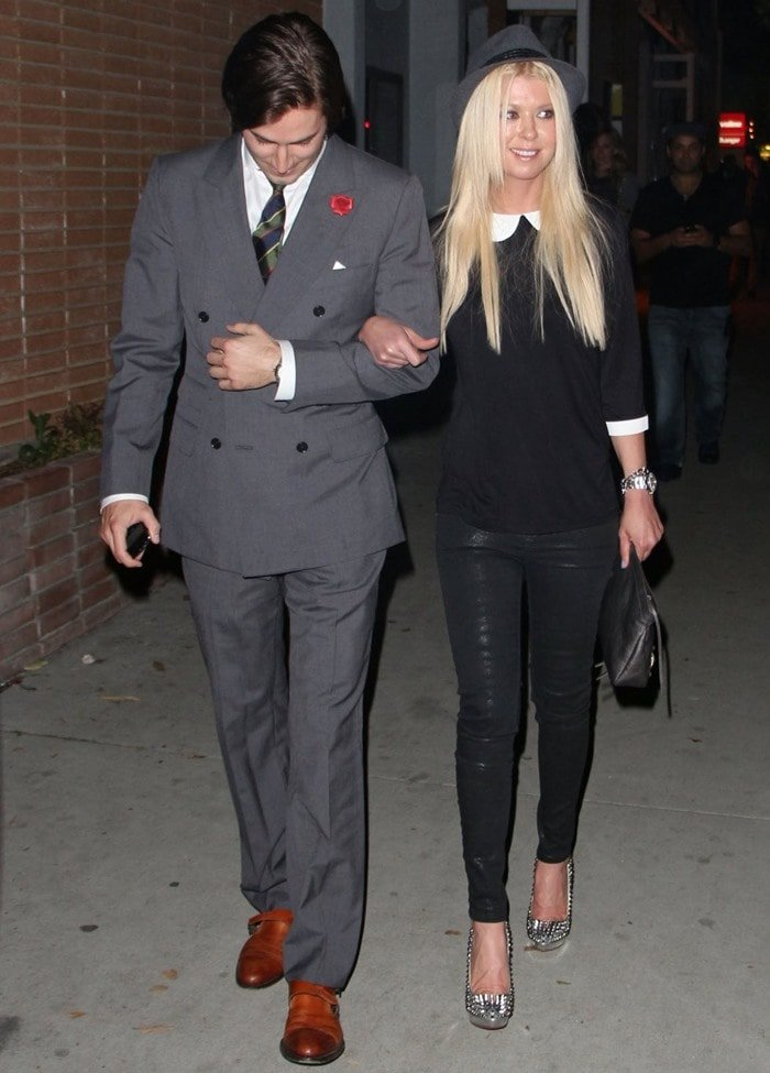 David Schechtmann and actress Tara Reid arrive at Park Place A Solo Show By Alec Monopoly