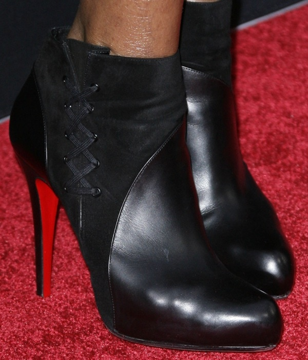 Tasha Smith rocks black Christian Louboutin red sole booties