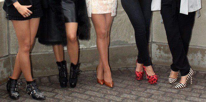 The Saturdays showing off their shoes