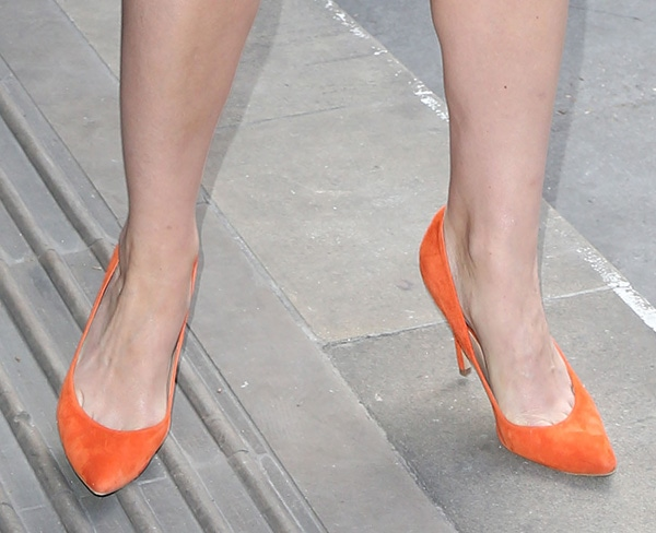 Trixie Franklin shows off her feet in orange suede pumps