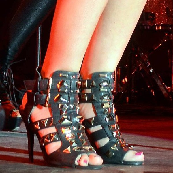 Tulisa's feet in cutout gladiator sandals